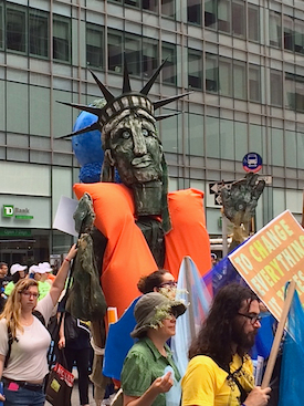 Lady Liberty on 42nd Street models what could be New York's trendiest fashion if sea levels rise. Photo by Hal J. Cohen.