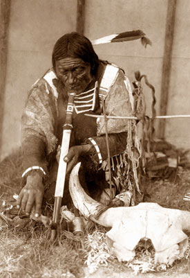 Joseph Wheezing Antelope, the grandfather of Joseph Panting Bear, lights up. Photo: Native American Archives.