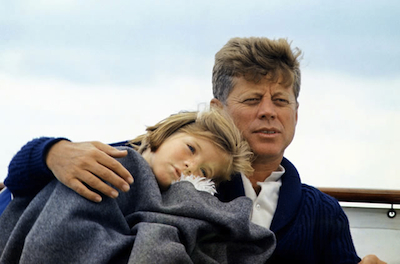 "Caroline Kennedy and her father John, at Hyannisport, Mass., aboard the ""Honey Fitz"" on August 25, 1963. Photo by Cecil Stoughton."