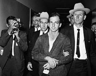 Oswald was originally taken into custody for the shooting of a cop, not the president. Conveniently, he was already in custody when he was named Kennedy's assassin.