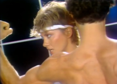 "video still from Olivia Newton John's ""Physical."""