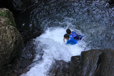 Boys playing in La Mina Falls, Puerto Rico. Photo by Amanda Painter.