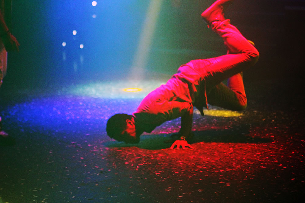 Testing gravity on a dance floor in Paris.  Photo by Danielle Voirin. Click on image to display a large version.
