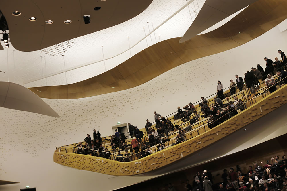 Audience on a balcony of the Grande Salle of the new Philharmonie de Paris, designed by architect Jean Nouvel.