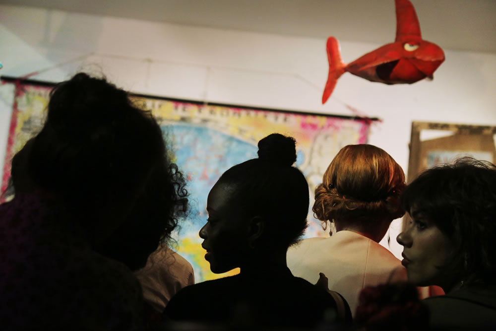 Profiles in a crowd, waiting for a concert to begin in the gallery at 59 rue de Rivoli, in Paris.