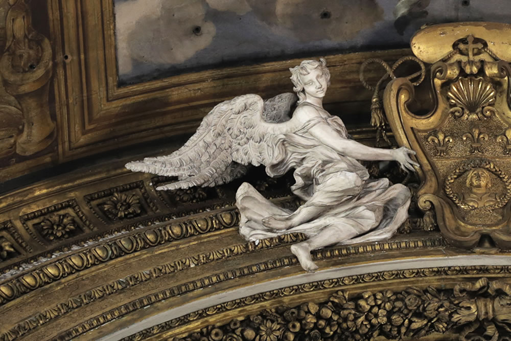 A most marvelous angel I felt observing us, sculpted and flying above an alter in Rome, at the church of Gésu e Maria on Via del Corso, completed in the late 17th century.