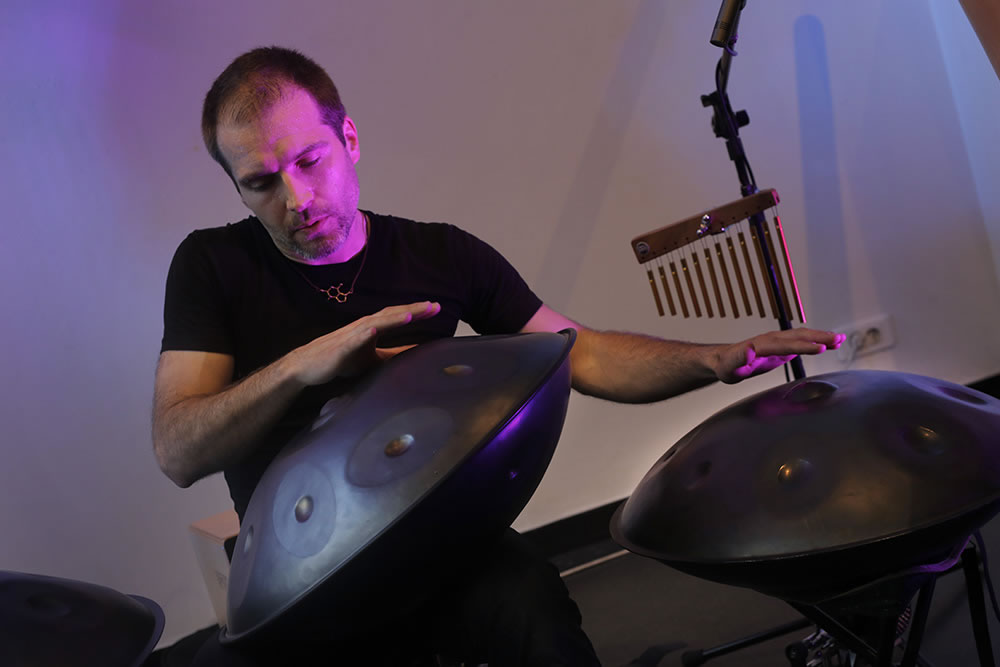 Jeremy Nattagh playing three handpans (also known as a hang or space drum), in concert at 59 Rivoli in Paris.