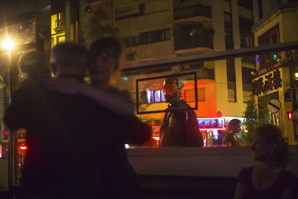 Watching tango dancers through the window of a corner bar in Belleville, Paris.