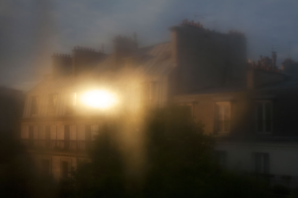 The sun reflected through a steamy window.  Temperatures are rising in Paris this week.