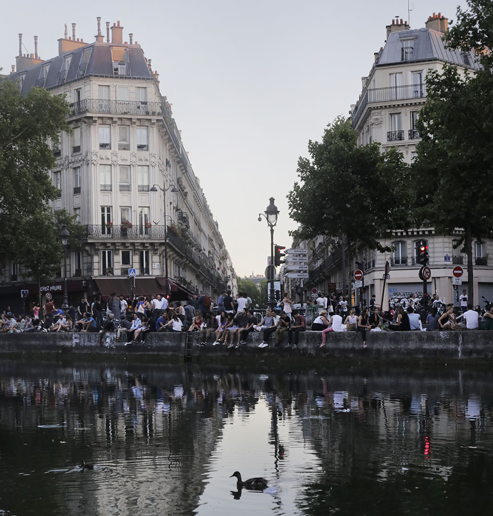 Parisians coping with the heat wave, having apéro picnics along the Canal St. Martin.