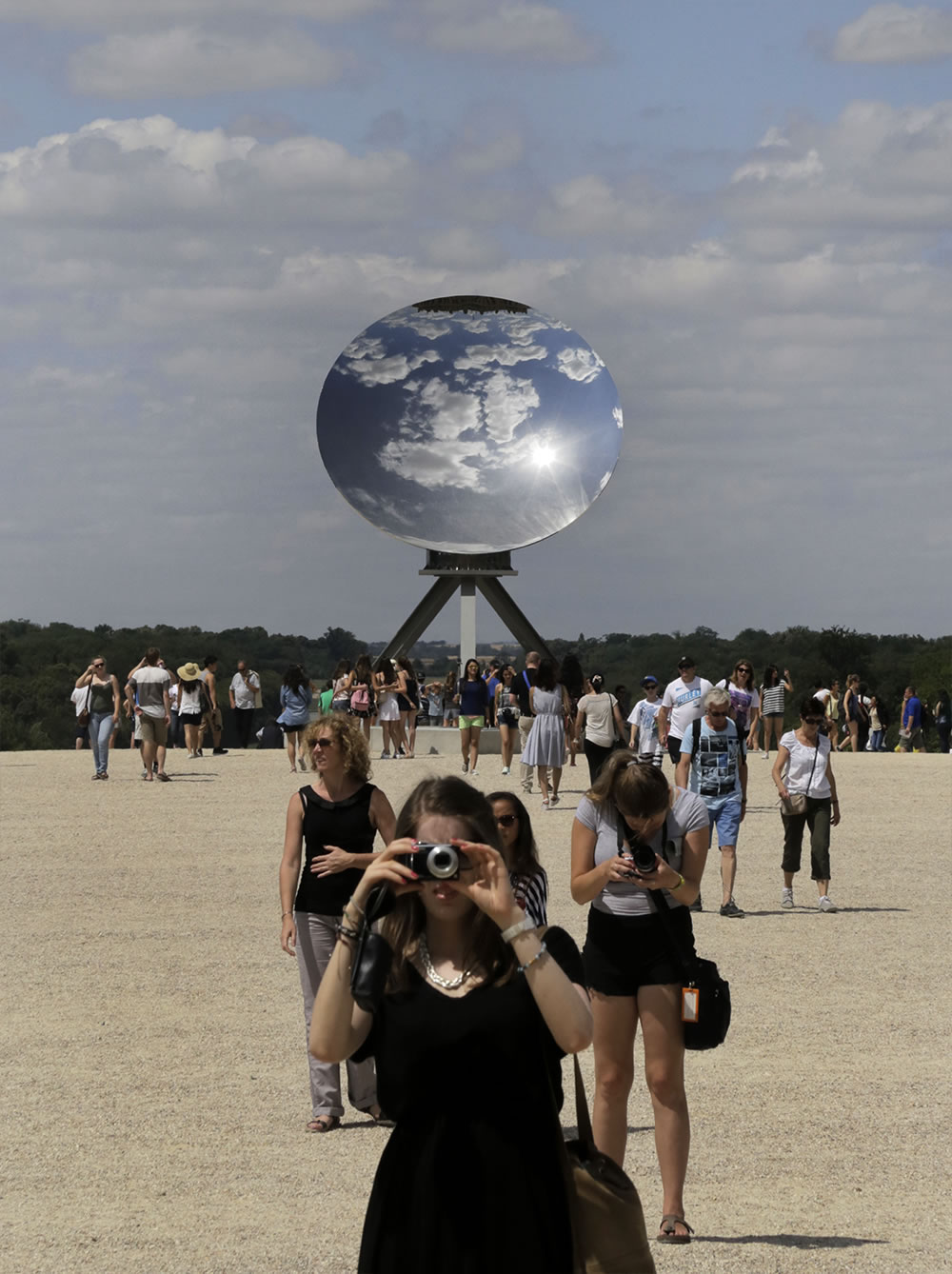 Anish Kapoor is this year's invited contemporary artist at Versailles.  His installations will be on display until November 1st.  Here his Sky Mirror stands on the plateau between the chateau and the gardens.