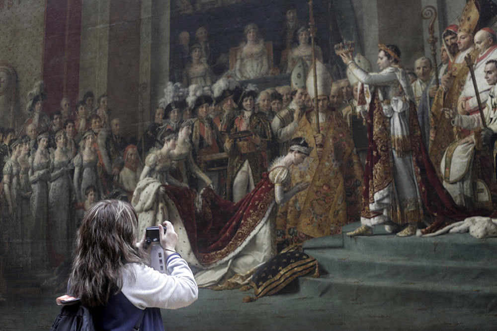"Photographing ""The Consecration of the Emperor Napoleon and the Coronation of Empress Joséphine on December 2, 1804,"" at the Louvre in 2015.  Jacques Louis David, the painter of this oeuvre, attended the actual coronation which took place in the Notre Dame Cathedral."