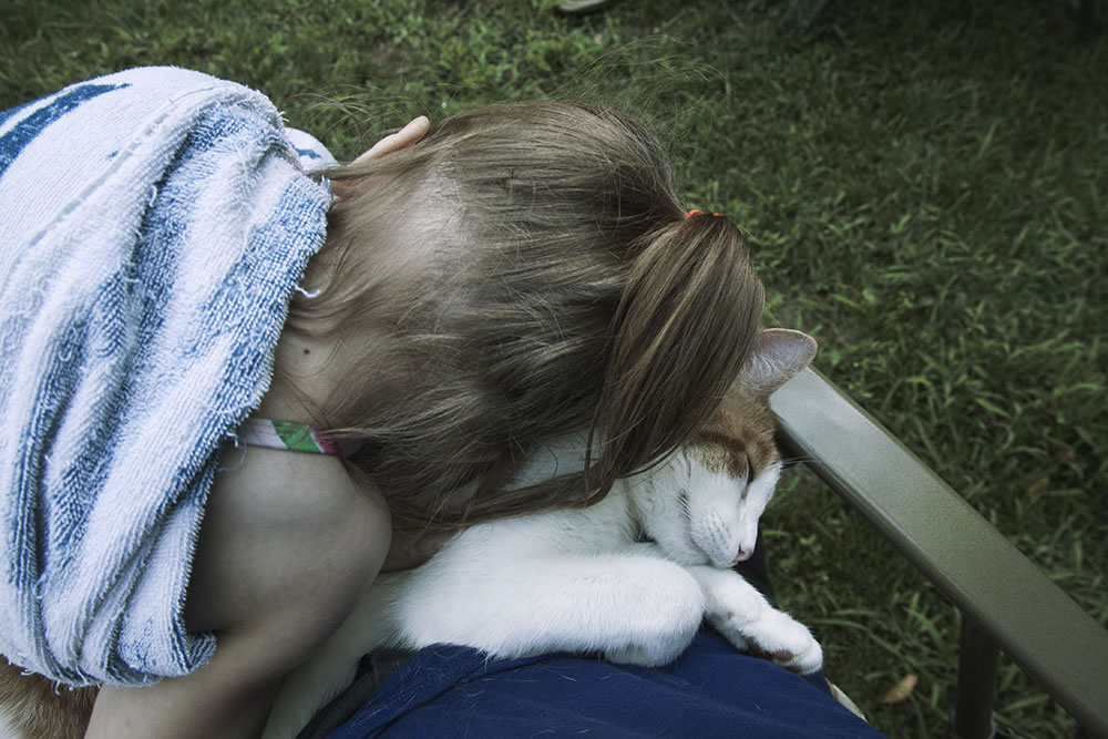 Love and a cuddle, at the end of an active summer day.