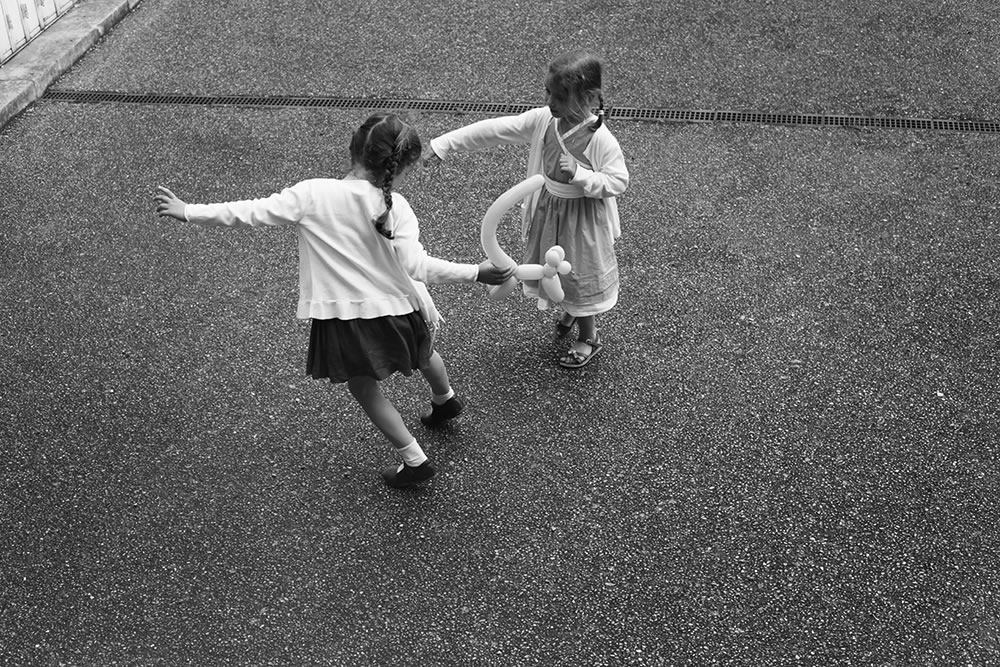 The dance of little girls at play.