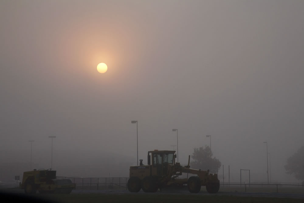 Early morning fog, before the construction workers arrive and block traffic.