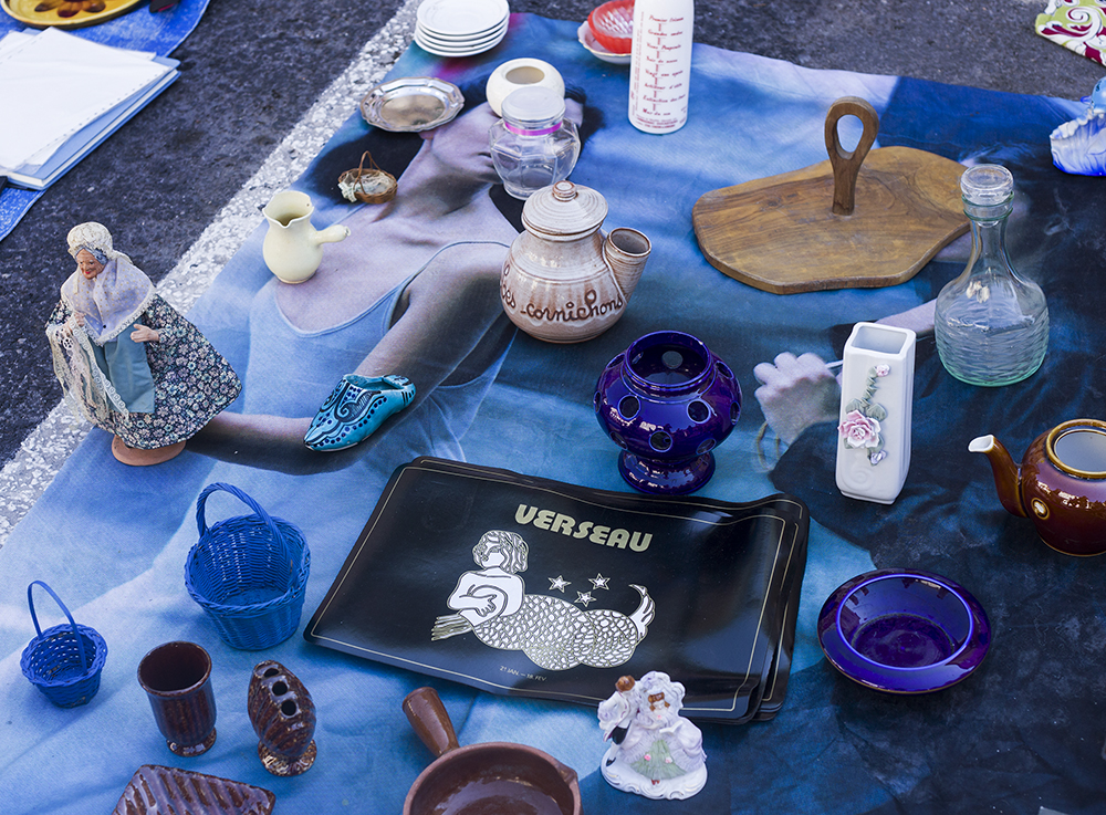 Aquarius (Verseau in French) place mats for sale at a flea market in Ganges, France.