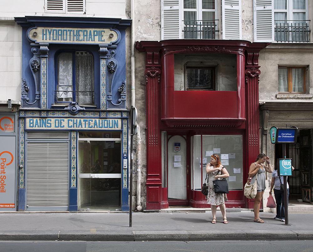 Waiting for the bus on rue du Faubourg Montmartre, Paris.