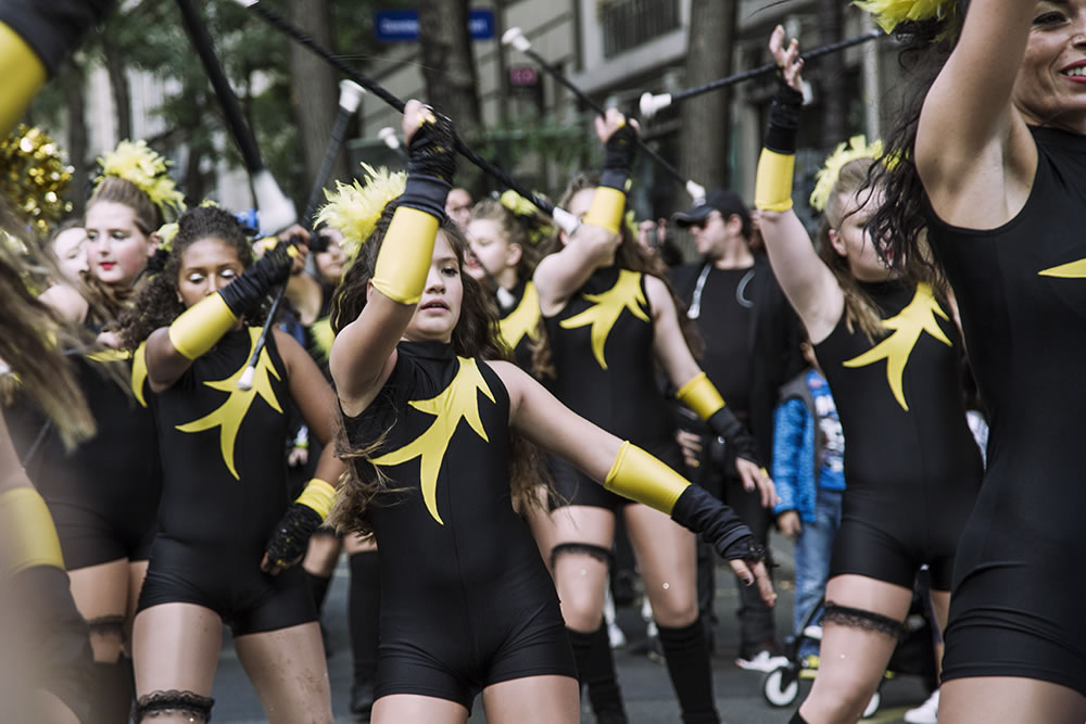 Majorettes march in a parade for the annual Harvest Festival in Montmartre, Paris over the weekend.