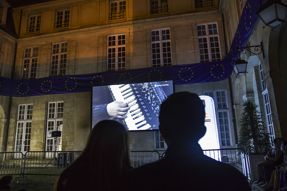 Watching short films in a 17th century courtyard in the Marais, during the annual Nuit Blanche (White Night, aka All-Nighter) arts festival.