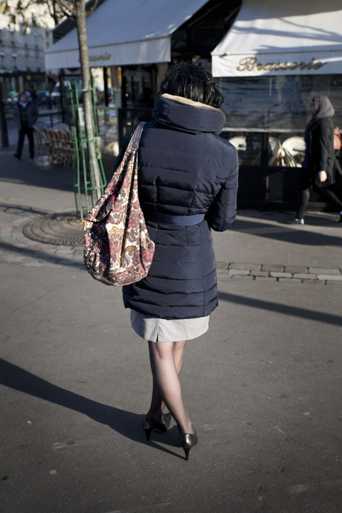 Une Parisienne, texting in front of the corner café, on a crisp autumn afternoon.