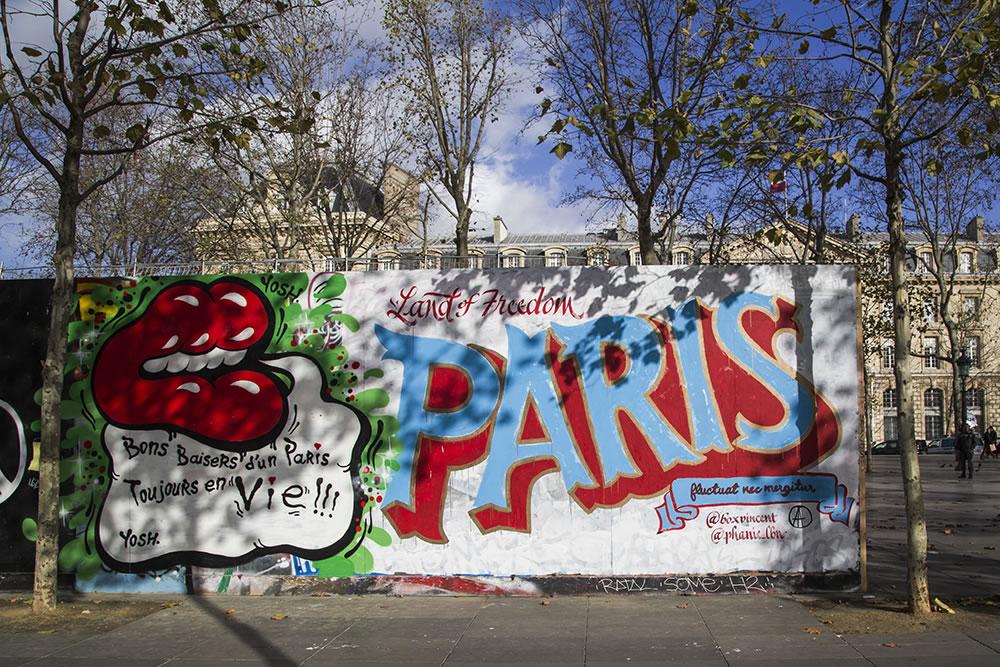 """""""Kisses from a Paris still Alive!!!""""  A wall around a café under reconstruction at Place de la République."""