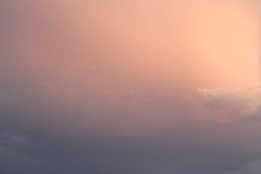 The only thing certain is change.  Cotton-candy pink slowly illuminates the city.  Will there be sun?  Will there be rain?
