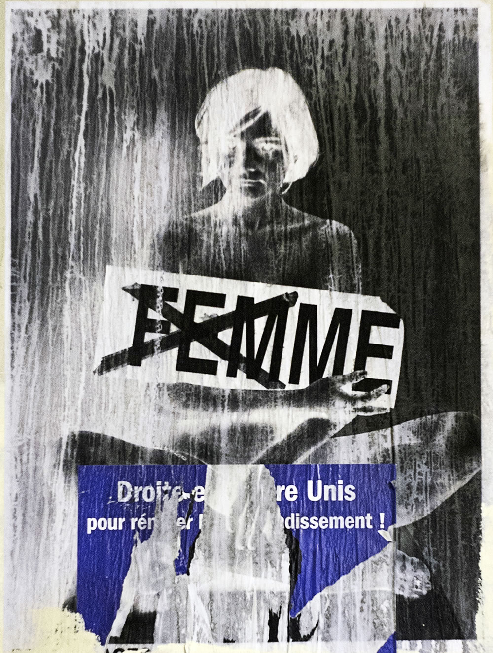 Street art semi-destroyed.  Femme - Woman.  Droits - Rights.  Unis - United.
