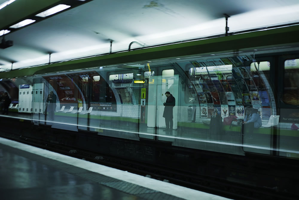 Waiting on a platform in an empty Paris metro.