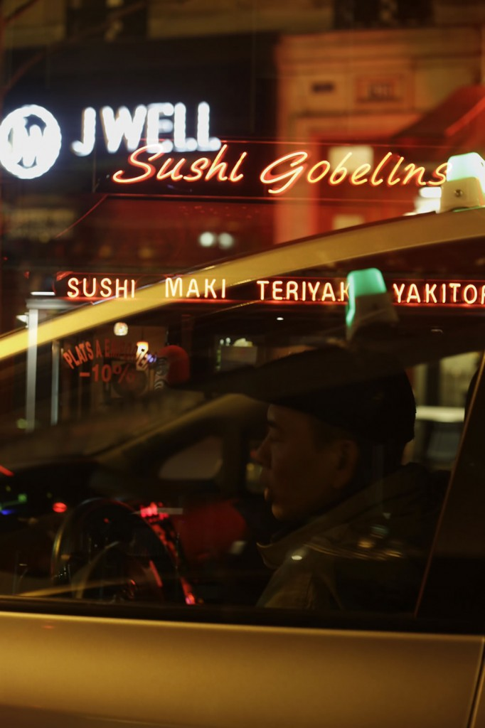Taxi driver, cruising down Avenue des Gobelins in Paris.
