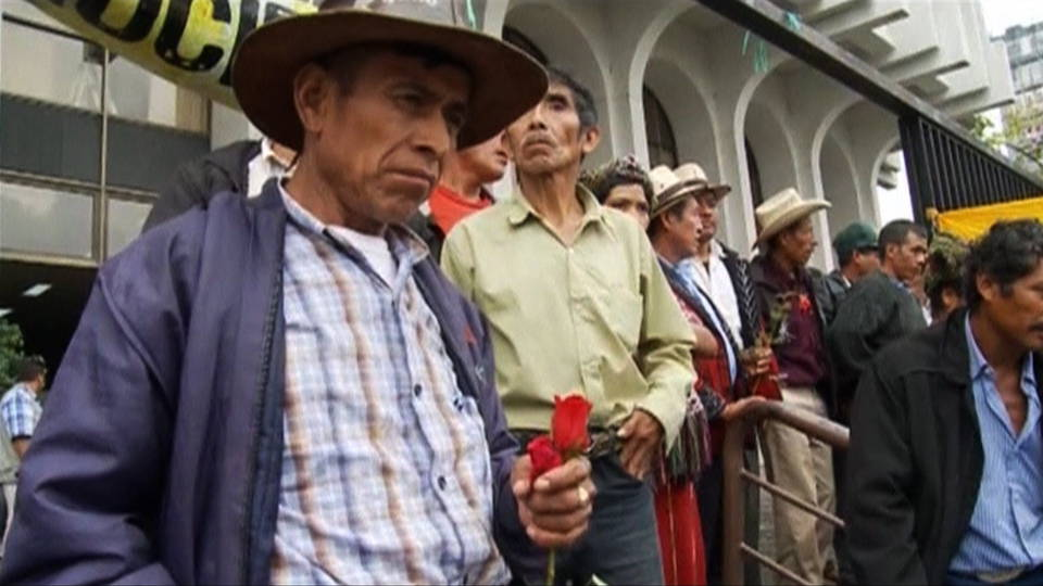 In Guatemala, police have arrested and indicted 18 ex-military leaders on charges of committing crimes against humanity during the decades-long, U.S.-backed dirty war against Guatemala's indigenous communities.