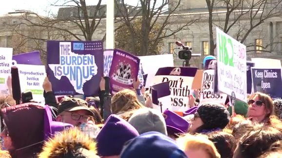"""Stop the Sham"": Thousands Rally as Supreme Court Hears Biggest Abortion Case in a Generation. Image: video still."