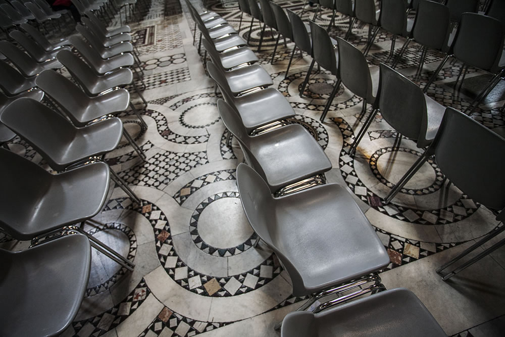 "Modern plastic chairs on the floor of the first church to be built in Rome, the Archbasilica of St. John Lateran (or as the neighbors called it, simply San Giovanni).  It's the cathedral of the bishop of Rome, and the Pope, putting it above St. Peters in the Catholic hierarchy. It's known as Omnium urbis et orbis Ecclesiarum Mater et Caput: ""Cathedral of Rome and of the World."""