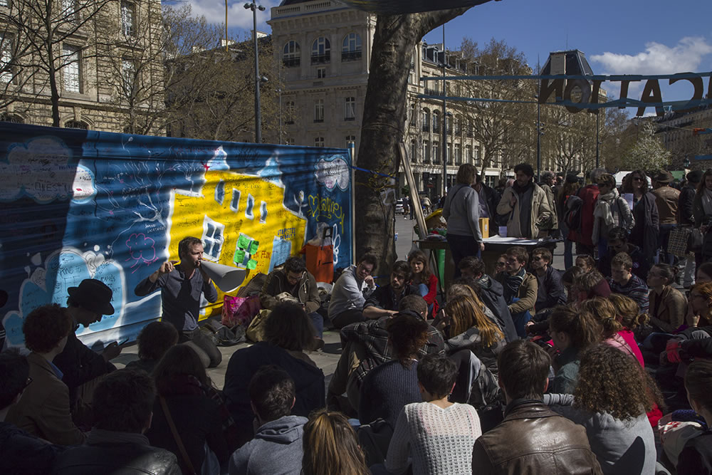"A community education class this weekend in Place de la République, Paris. Since March 31st, the movement Nuit Debout (""rise up at night""), compared to Occupy and Les Indignados, has been occupying the square day and night."