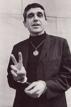 Father Daniel Berrigan handcuffed, circa 1968.