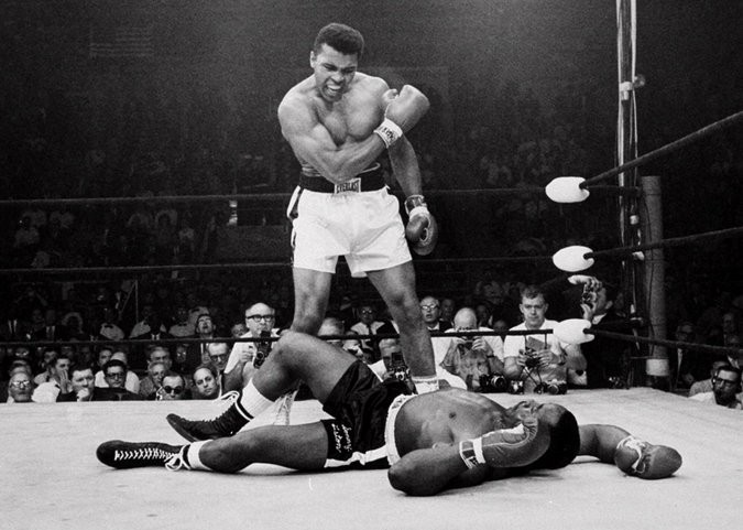 Muhammad Ali standing over Sonny Liston in 1965 in their second fight. Ali was declared the winner in that fight and retained the world title. Credit: John Rooney/Associated Press.