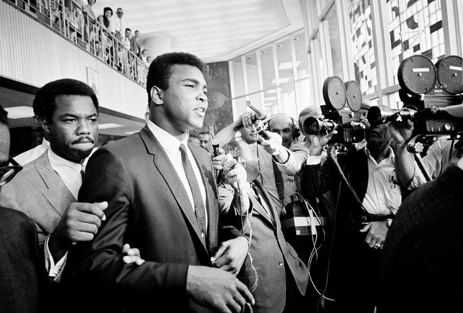 In April 1967, Ali refused to be drafted and requested conscientious-objector status. He was immediately stripped of his title by boxing commissions around the country. Several months later he was convicted of draft evasion, a verdict he appealed. Credit: Ed Kolenovsky/Associated Press