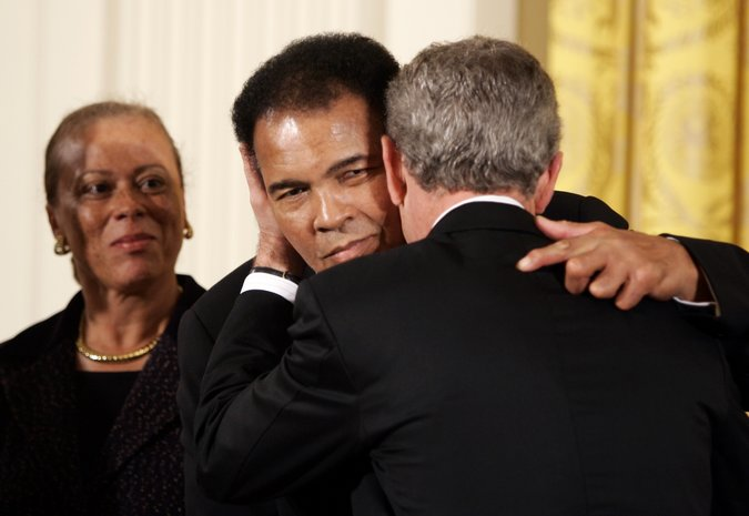 Calling him the greatest boxer of all time, President George W. Bush presented the Medal of Freedom to Ali in a White House ceremony in 2005. Credit: Kevin Lamarque/Reuters