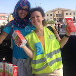 Marcy Franck and another volunteer at Souda Camp in Greece. Photo by Marcy Franck.
