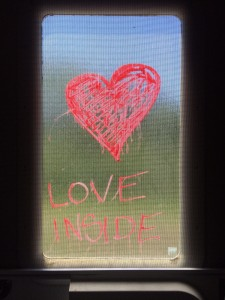 Caption: A window decoration on an RV traveling with the UpToUs Caravan. Photo credit: Johnny (last name unknown).