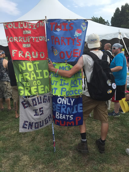 One person, many statements: an activist waiting for Jill Stein to speak in FDR Park on Monday. Photo by Amy Jacobs.