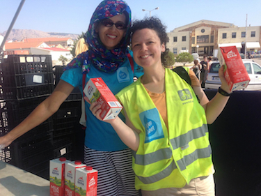 "The two Milk Maids of Souda Camp. ""She handed me cups as I barked things like 'Let's make a box of four!'"" Photo courtesy of Marcy Franck."