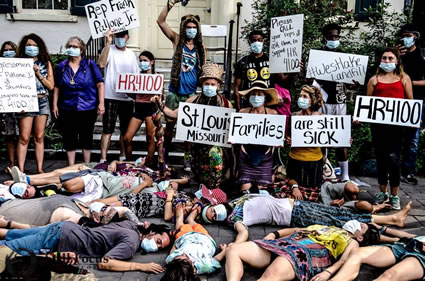 "A ""die-in"" on the streets of Philly, staged by activists from St. Louis, MO, where a nearby landfill has been shown to contain nuclear waste. Photo by Shaunti Lallyiam,"