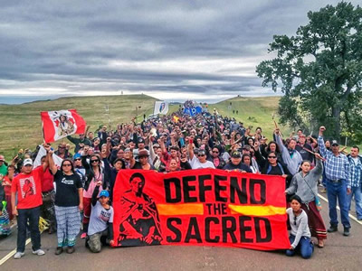 A solidarity march from September 4th joined by almost all campers and activists. Photo by Dallas Goldtooth, from www.ecowatch.com.