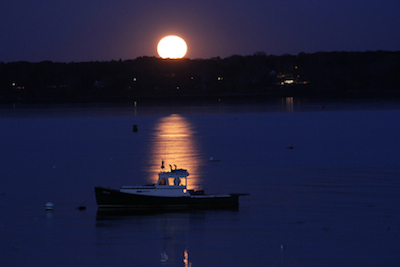 Taurus Full Moon rising over the islands of Casco Bay off Portland, Maine. Photo by Amanda Painter.