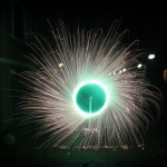 Rotating_green_fireworks_in_a_wheel_spinning_Holland