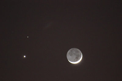 """The February 2015 conjunction of Venus and Mars, with a crescent Moon mimicking this week's Full Moon thanks to a phenomenon known as """"Earthshine."""" Photo by Amanda Painter."""