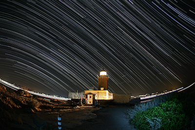 Star trails over the lighthouse at Cape Melagavi, Greece. Photo by Anthony Ayiomamitis.