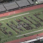 """Students in the Granada Hills area of Los Angeles spelled out a message to lawmakers during a Wednesday walkout in response to gun violence, lying silently in the formation of """"ENOUGH,"""" with 17 chairs lined up representing the 17 students killed in Parkland, FL, one month ago. Photo by NBC Los Angeles."""