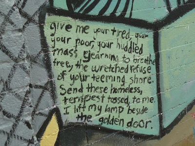 """Excerpt from """"The New Colossus"""" by Emma Lazarus; photo of a mural in Phoenix, Arizona."""