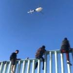 SEG-MigrantsClimbingWall